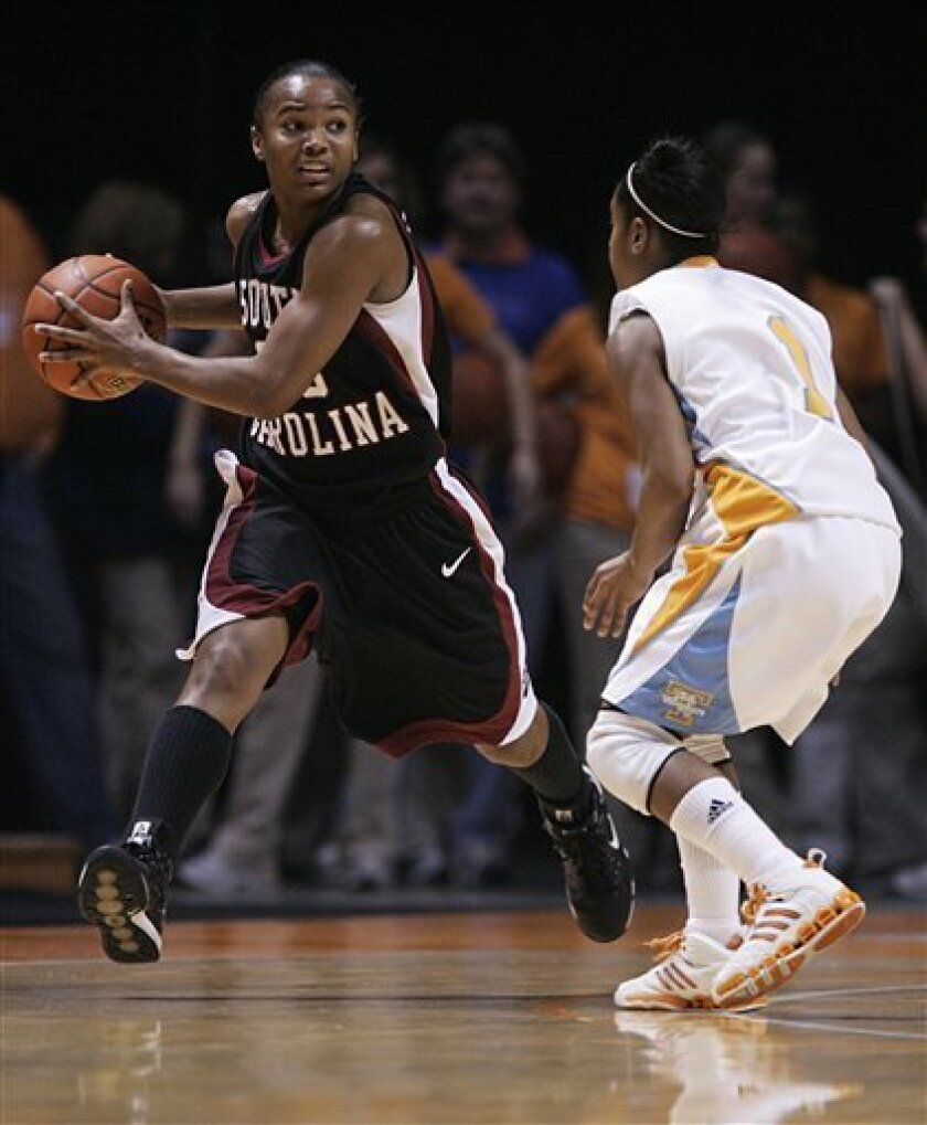 South Carolina's Brionna Dickerson, left, works the ball against Tennessee's Briana Bass (2) during the first half of an NCAA college women's basketball game Sunday, Jan. 18, 2009 in Knoxville, Tenn. (AP Photo/Wade Payne)