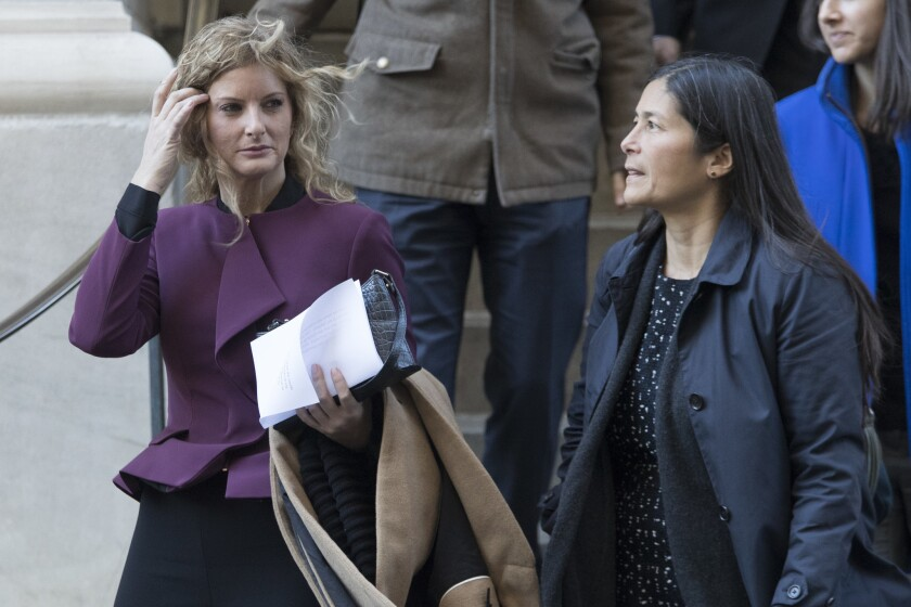 Summer Zervos (l.) leaves New York state appellate court with her attorney Mariann Wang.