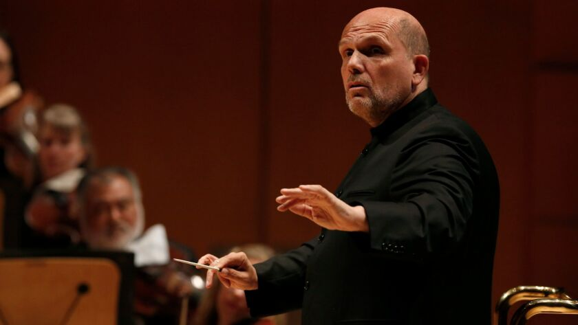 Jaap van Zweden, the New York Philharmonic music director designate, leads the L.A. Phil in a program of Beethoven and Shostakovich fifth symphonies Friday.