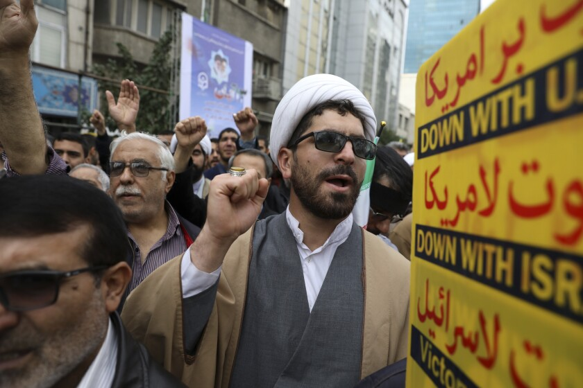 A Shiite Muslim cleric chants slogan during an anti-U.S. annual rally in front of the former U.S. Embassy in Tehran, Iran, Monday, Nov. 4, 2019.