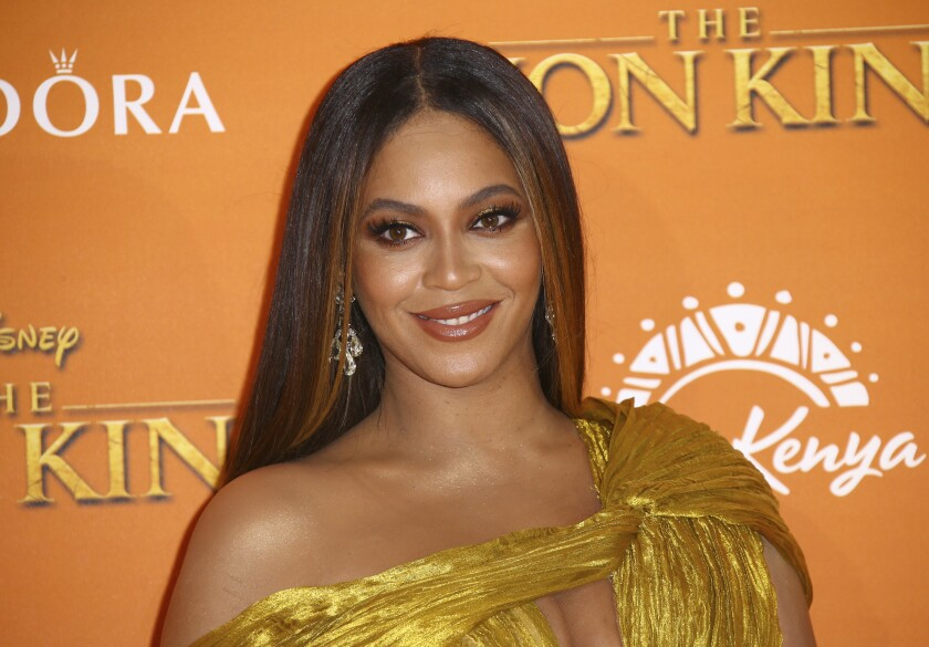 "FILE - This July 14, 2019 file photo shows Beyonce at the ""Lion King"" premiere in London. President Barack Obama along with his wife, Michelle, delivered speeches Sunday, June 7, 2020, during YouTube's ""Dear Class of 2020"" virtual ceremony. The duo, along with a wide-ranging, star-studded lineup including Beyoncé, Lady Gaga and Tom Brady, offered inspirational messages in hopes of uplifting new graduates. (Photo by Joel C Ryan/Invision/AP, File)"