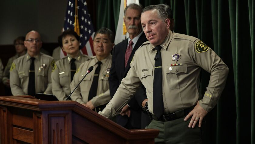 Los Angeles County Sheriff Alex Villanueva, who was sworn in last month, holds a press conference in Los Angeles on Jan. 30.