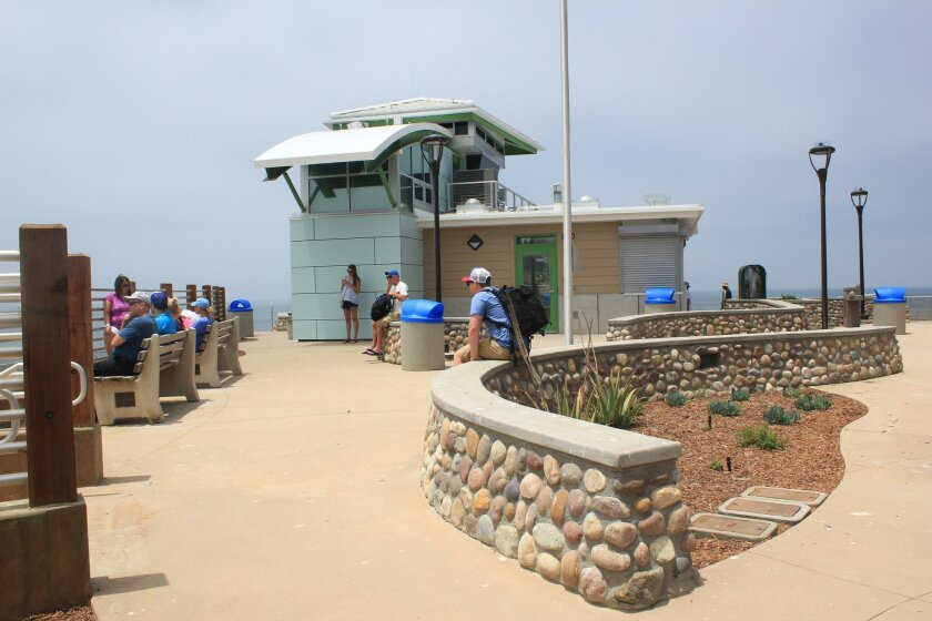The new design includes landscaping and benches overlooking the north side of the beach.