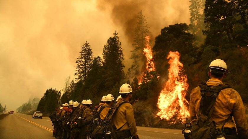 Firefighters monitor the Delta fire along Interstate 5 north of Redding on Sept. 7.