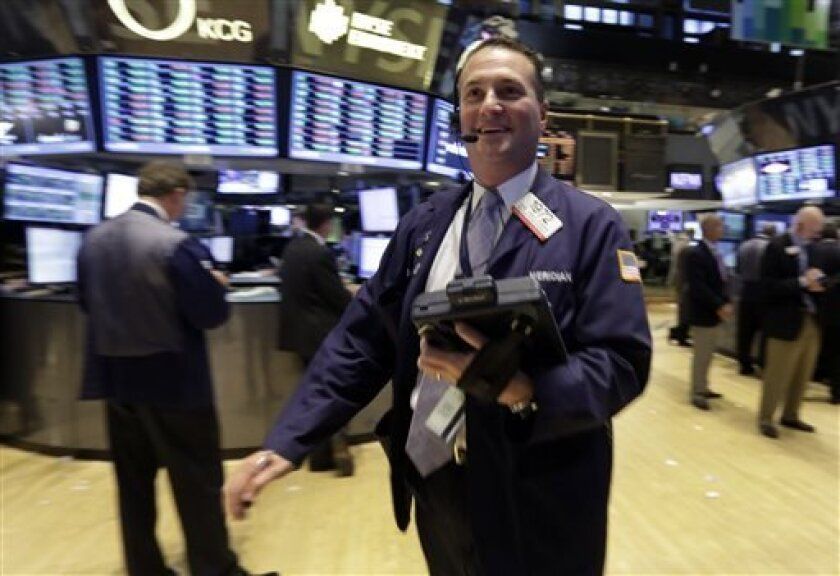 Trader Jonathan Corpina works on the floor of the New York Stock Exchange Wednesday, Sept. 18, 2013. The stock market hit a record high Wednesday after the Federal Reserve's surprise decision to keep its economic stimulus in place. (AP Photo/Richard Drew)