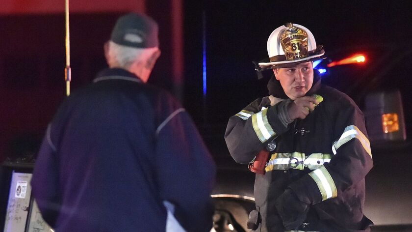 One of the first responders work the scene of an explosion and reported stand-off in North Haven, Co
