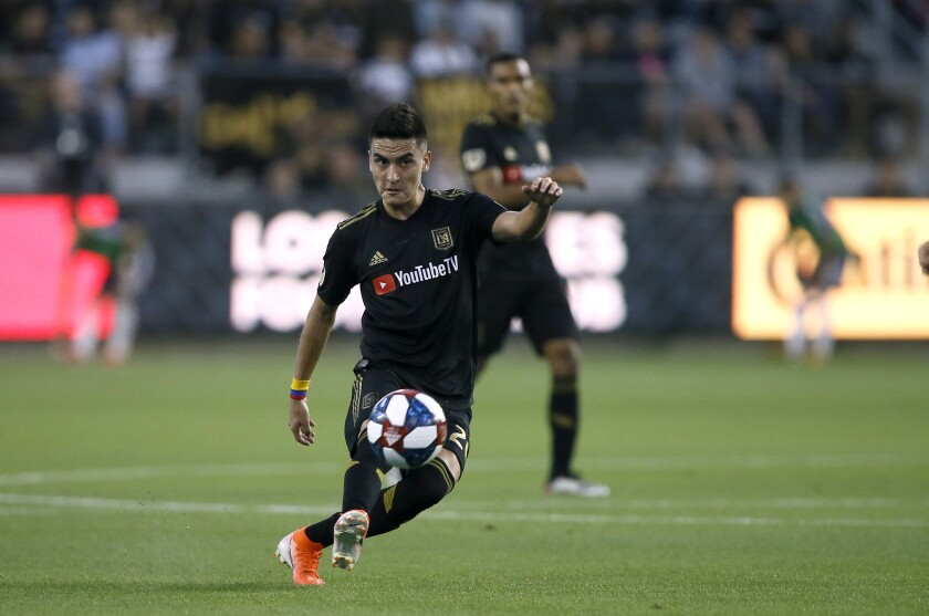 Los Angeles FC midfielder Eduard Atuesta (20) passes the ball during the first half of a Major League Soccer game against the Vancouver Whitecaps in Los Angeles, Saturday, July 6, 2019. (AP Photo/Alex Gallardo)