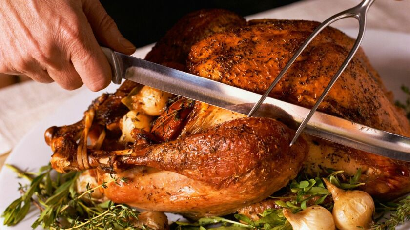 A good soak in a salt solution -- like this beer brine -- makes a turkey more moist and flavorful.