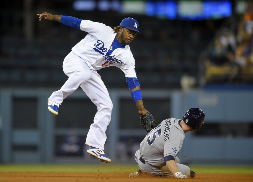 San Diego Padres' Cory Spangenberg is tagged out by Los Angeles Dodgers shortstop Hanley Ramirez as he tries to steal second during the fifth inning of a baseball game, Wednesday, Sept. 10, 2014, in Los Angeles. (AP Photo/Mark J. Terrill)