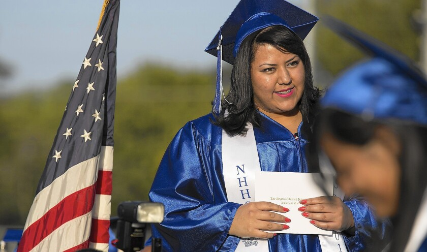 Clarisa Ortega waits to accept her diploma at her North Hollywood High graduation ceremony.