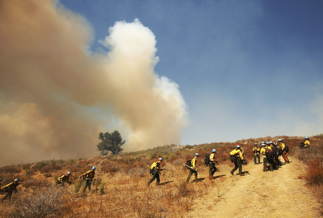 Firefighters from California Conservation Corps prepare as flames from the Alisal Fire move toward La Paloma Ranch.