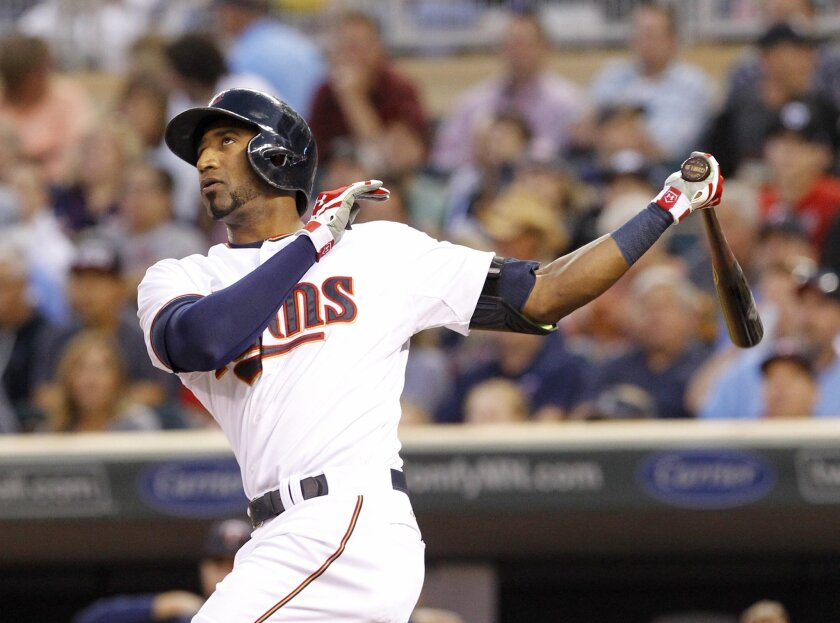 Minnesota Twins' Eduardo Nunez follows through on a solo home run off Houston Astros starting pitcher Scott Kazmir during the third inning of a baseball game in Minneapolis, Friday, Aug. 28, 2015. (AP Photo/Ann Heisenfelt)