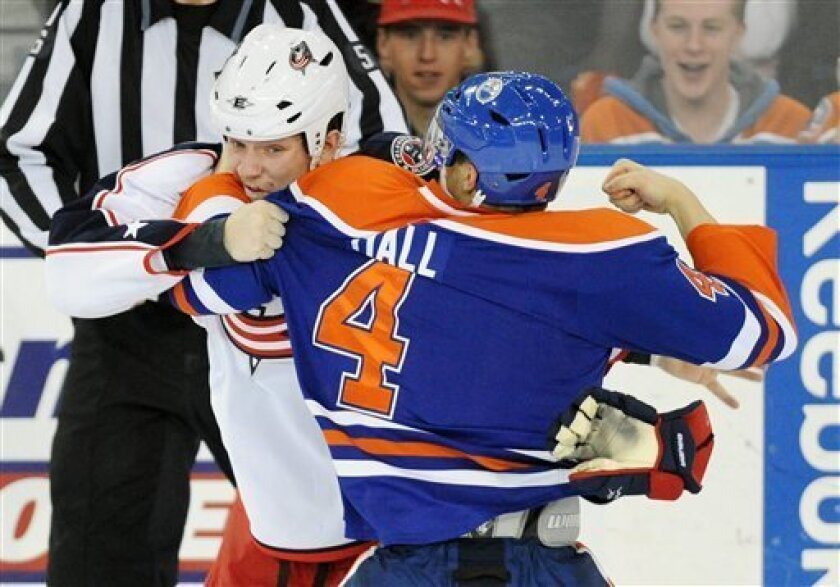 Columbus Blue Jackets Derek Dorsett, left, and the Edmonton Oilers' Taylor Hall fight, during second-period NHL hockey game action in Edmonton, Alberta, Thursday, March 3, 2011. (AP Photo/The Canadian Press, John Ulan)