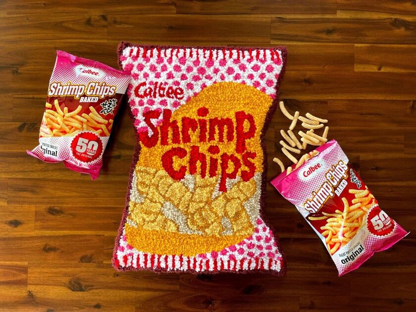 A rug made to look like a bag of shrimp chips.