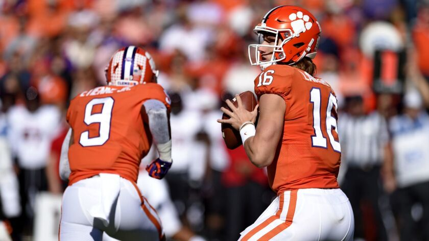 Clemson's Trevor Lawrence drops back to pass during the first half of an NCAA college football game