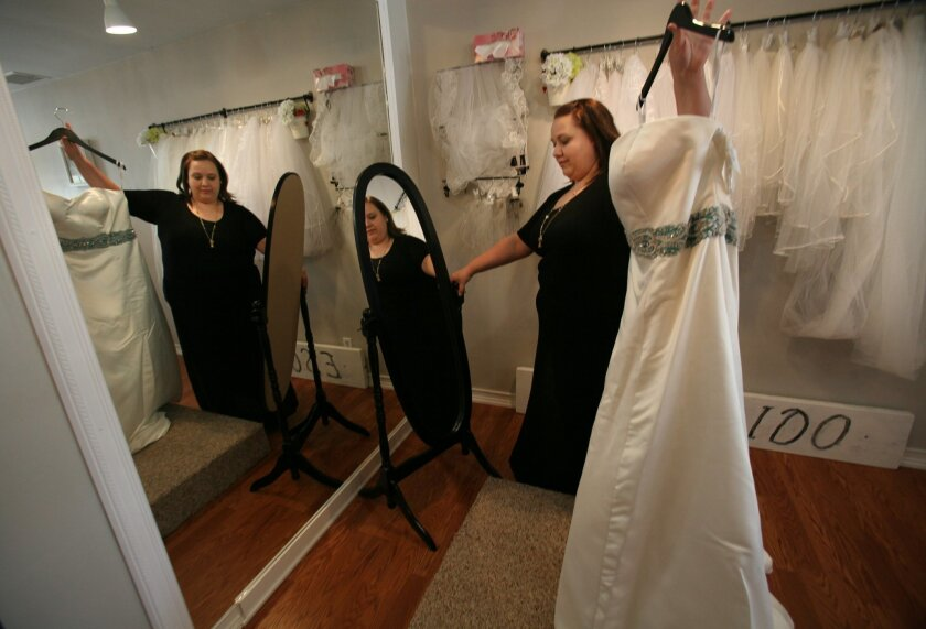 Danielle Springer has opened Unveiled Bridal, what she says is the first bridal shop in San Diego County that sells only plus-size wedding gowns, bridesmaids dresses and accessories. Her Escondido shop opened just four months ago.