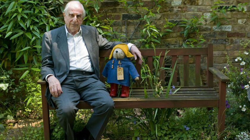 British author Michael Bond sits with a Paddington Bear toy during a 2008 interview in London.