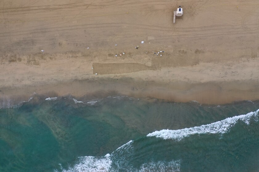 An aerial view of oil on the sand at Huntington Beach.
