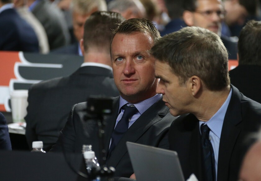 Kings general manager Rob Blake, left, sits next to Kings president Luc Robitaille.