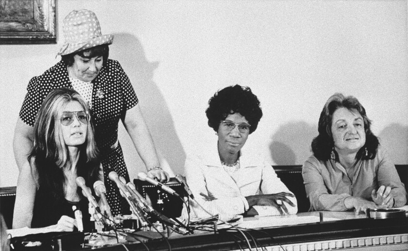 At a Washington news conference on July 12, 1971, members of the National Women's Political Caucus state that one of their goals is for women to comprise half of the delegates to the 1972 presidential conventions. Seated from left: Gloria Steinem, Rep. Shirley Chisholm (D-N.Y.) and Betty Friedan. Standing is Rep. Bella Abzug (D-N.Y.).