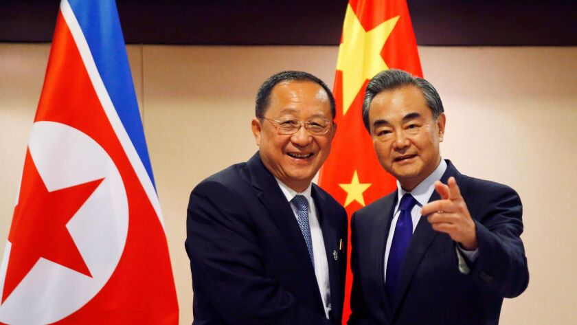 North Korean Foreign Minister Ri Yong Ho, left, with Chinese counterpart Wang Yi in Manila on Aug. 6