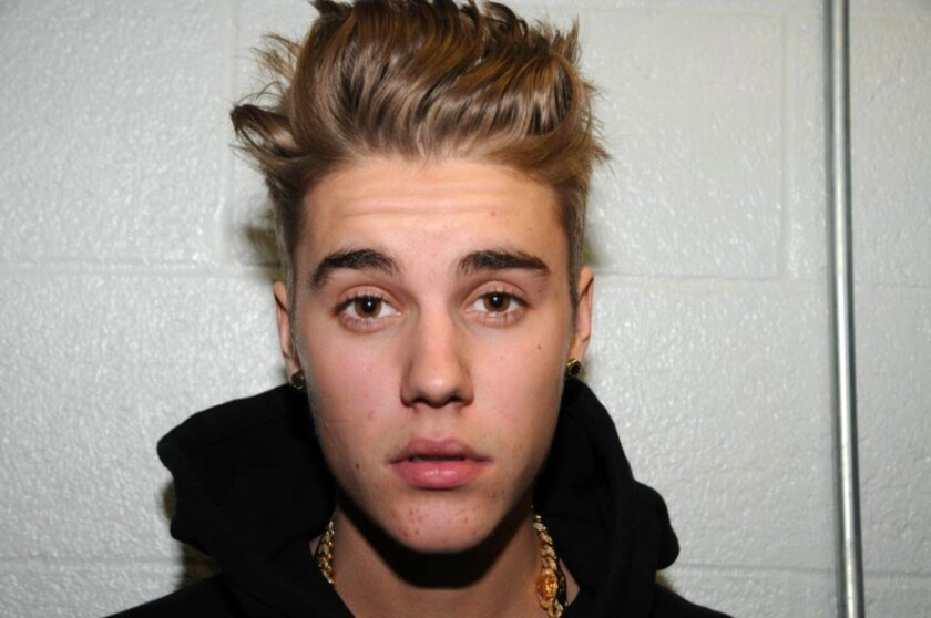 Taco Bell president tells Canadians if they want the new breakfast menu, they have to take Justin Bieber back.