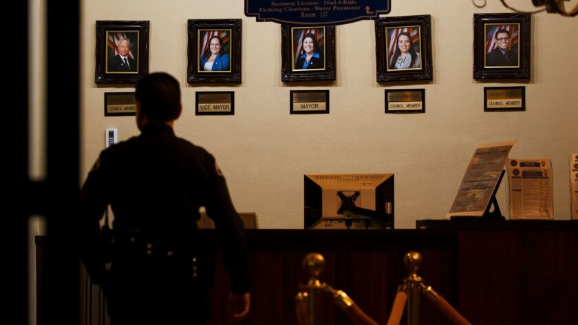 Portraits of Huntington Park council members are displayed inside City Hall.