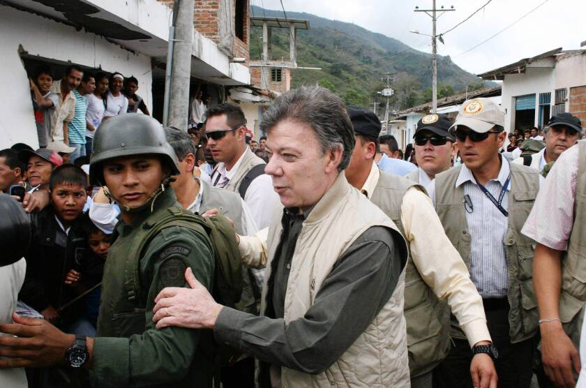President Juan Manuel Santos visits Toribio, in southern Colombia, on July 11, 2012, after an attack by FARC rebels.