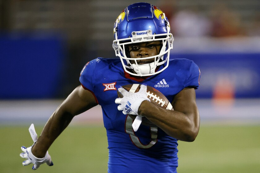 FILE - Kansas running back Velton Gardner carries the ball during an NCAA college football game in Lawrence, Kan., in this Friday, Sept. 3, 2021, file photo. Kansas running back Velton Gardner, who led the Jayhawks in rushing last season, has entered the transfer portal after seeing his playing time decrease over the first three games under new coach Lance Leipold. (AP Photo/Colin E. Braley, File)
