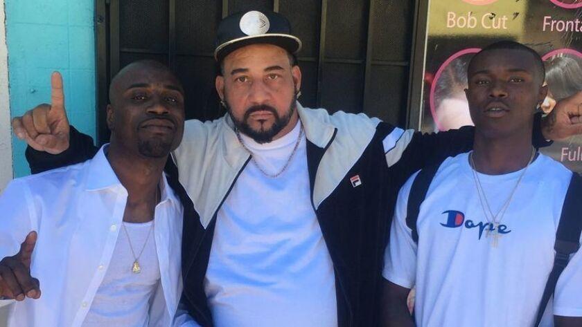 Willie McCoy, right, cousin David Harrison, center, and nephew Danaree Cole.
