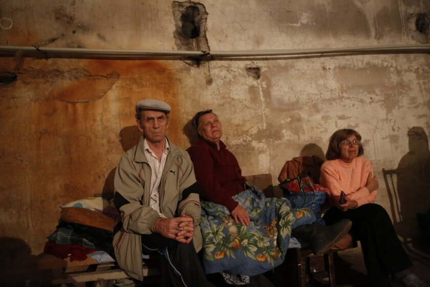 Residents of Donetsk, in eastern Ukraine, sit in a basement where they took shelter during shelling in the city Aug. 20.