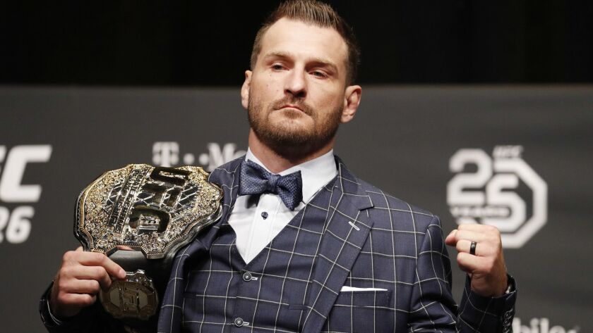 Stipe Miocic poses during a news conference for UFC 226, Thursday, July 5, 2018, in Las Vegas. Mioci