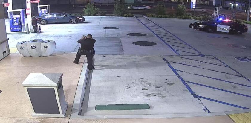 An image shows San Bernardino police and a man holding an object.