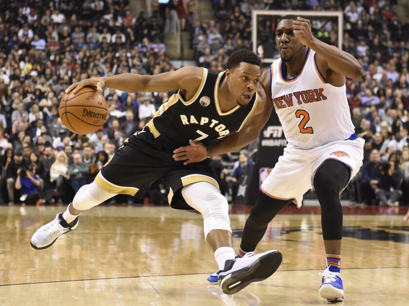 FILE - In this Jan. 28, 2016, file photo, Toronto Raptors' Kyle Lowry (7) drives past New York Knicks' Langston Galloway (2) during the first half of an NBA basketball game in Toronto. All-Stars Lowry and DeMar DeRozan have pushed the Raptors to the second-best record in the Eastern Conference at t