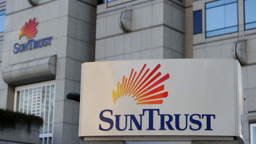SunTrust agreed to combine with BB&T in a $28-billion deal. The resulting bank would have branches throughout the Southeastern United States.