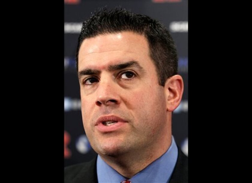 FILE - In this Jan. 31, 2012 file photo, Rutgers athletic director Tim Pernetti answers a question in Piscataway, N.J. A person familiar with the decision says Pernetti is out as Rutgers athletic director, Friday, April 5, 2013. (AP Photo/Mel Evans, File)
