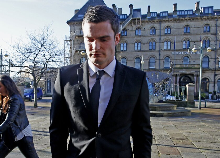 Sunderland winger Adam Johnson arrives at Bradford Crown Court, England, Wednesday Feb. 10, 2016. Johnson has pleaded guilty in court to one count of sexual activity with a child and another of grooming. The 28-year-old Johnson, who has made 12 appearances for England, denies two charges of sexual
