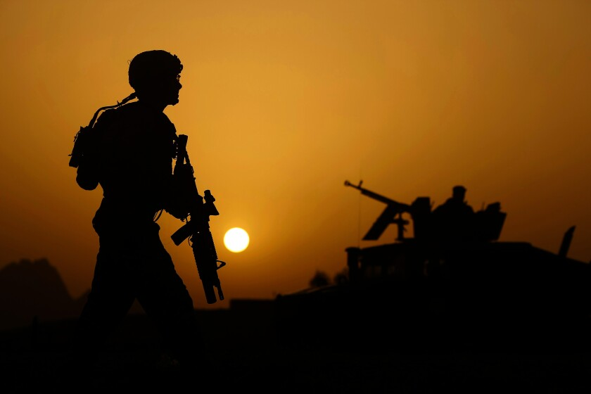 A U.S. soldier patrols in Kandahar, Afghanistan, in 2010.