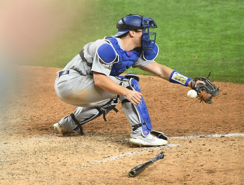 Dodgers catcher Will Smith drops the ball, allowing the Tampa Bay Rays to score the winning run.