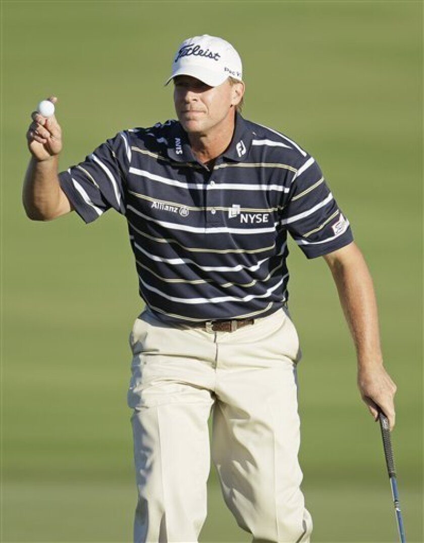 Steve Stricker reacts after making a birdie putt on the 18th green during the first round of the Hyundai Tournament of Champions PGA Tour golf tournament in Kapalua, Hawaii, Friday, Jan. 6, 2012. Stricker is tied for second place and is one stroke off the lead after shooting a 5-under-par 68. (AP Photo/Eric Risberg)