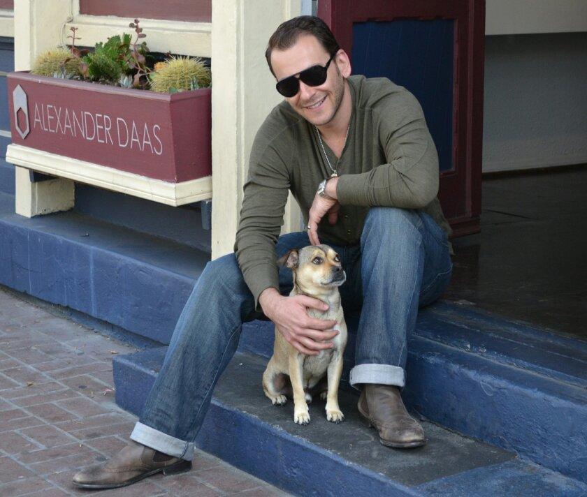 Alexander Daas outside his Gaslamp showroom with pet Czar Puptician. Courtesy photo