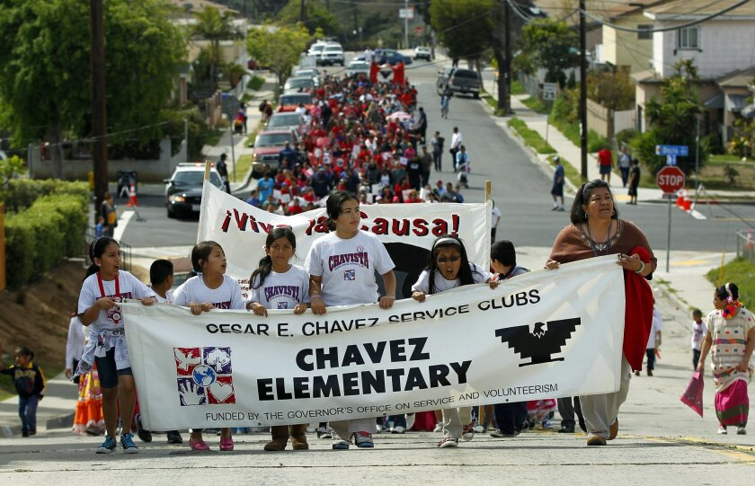 Students from the Cesar Chavez Service Club at Cesar Chavez Elementary School lead students and faculty along 40th St. during a march and festival last week.