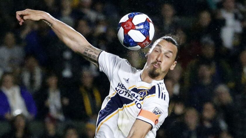LA Galaxy forawrd Zlatan Ibrahimovic (9) of Sweden, heads the ball during an MLS soccer match betwee