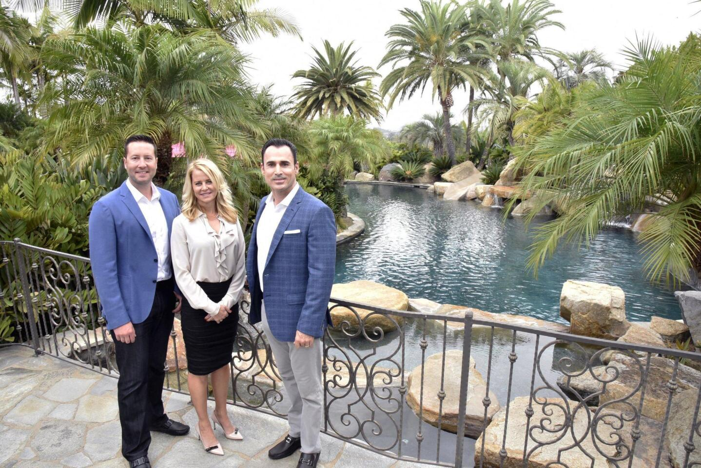 Barry Estates Realtor Ryan McGovern, Realtor Kendra Gibilisco, and Broker Jason Barry at their listing on La Valle Plateada in Rancho Santa Fe