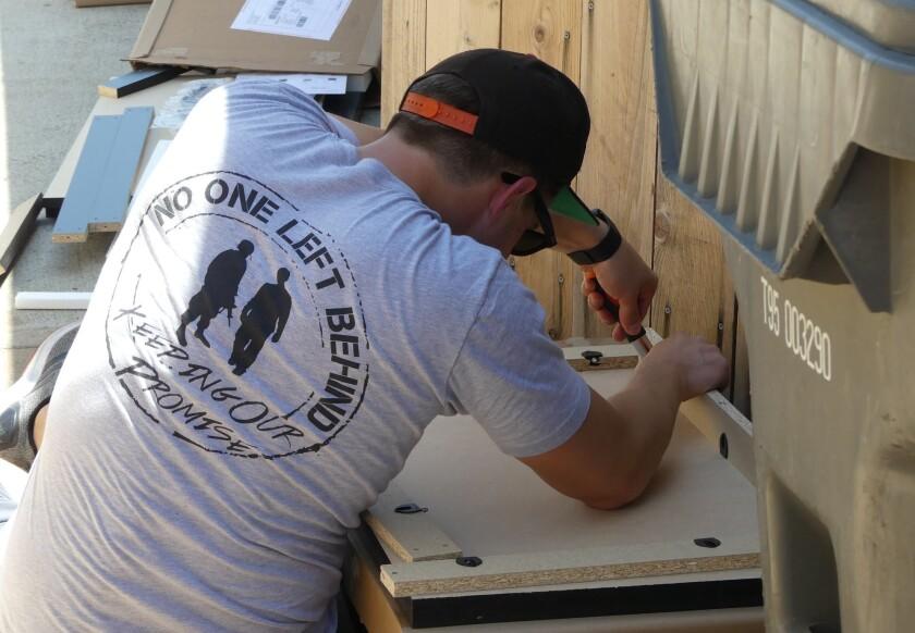 Matt Makowski works on a project building furniture at No One Left Behind.
