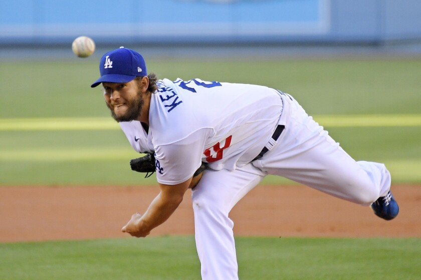 Dodgers' Clayton Kershaw delivers a pitch during a game against the Giants.