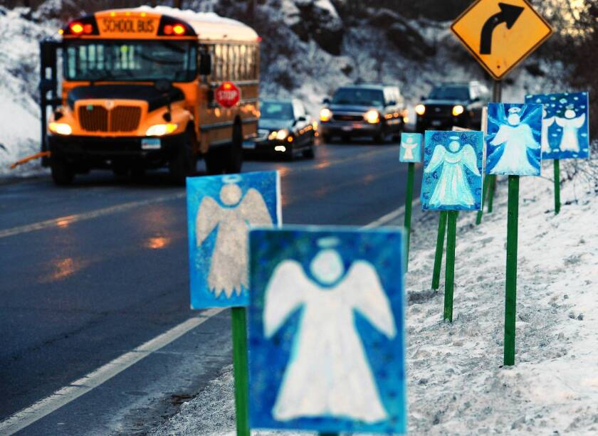 A bus traveling from Newtown, Conn., to nearby Monroe passes 26 angels representing those killed at Sandy Hook Elementary School.