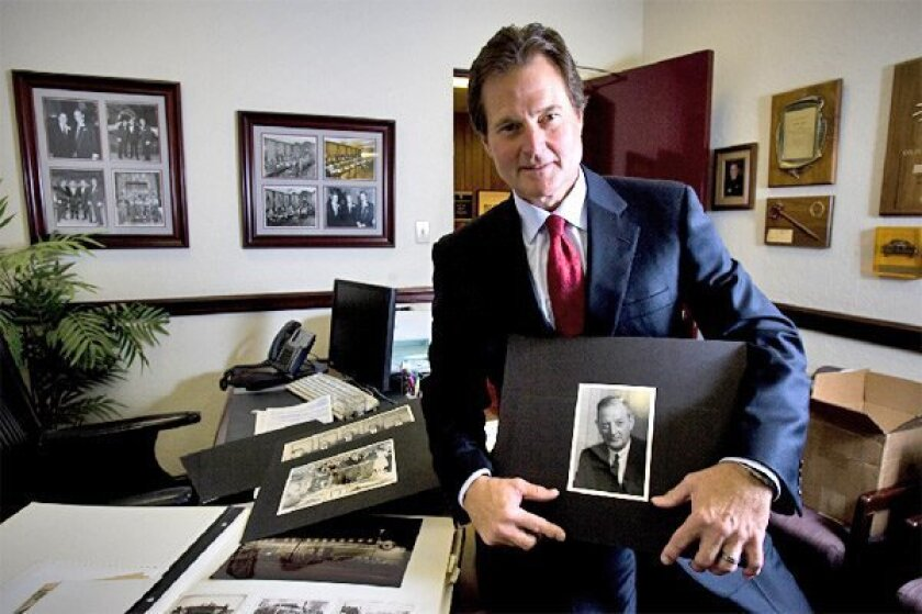 John Hine Jr.'s dealership is filled with photos of his dad and GM luminaries such as Alfred Sloan and Bunkie Knudsen. (Nelvin C. Cepeda / Union-Tribune)