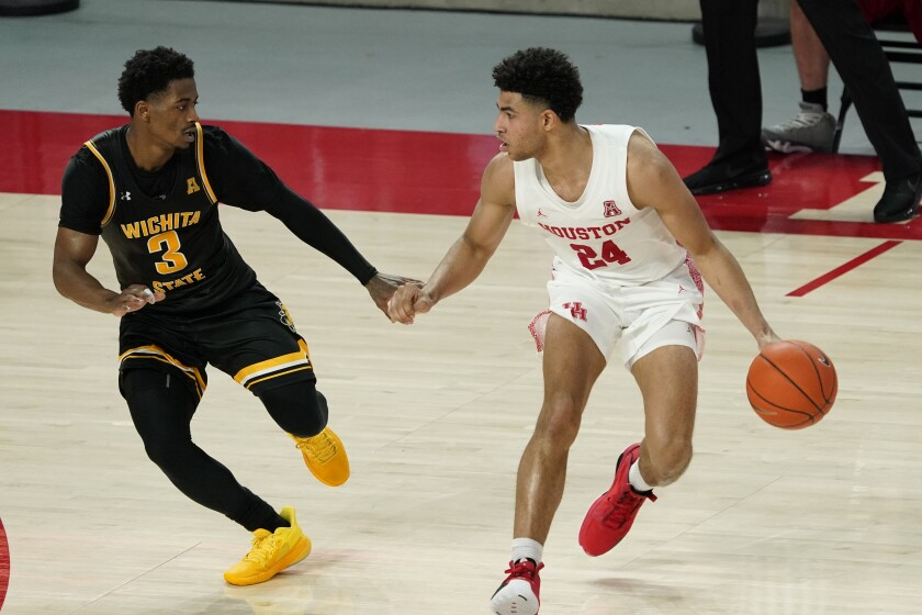 Wichita State's Alterique Gilbert (3) defends against Houston's Quentin Grimes (24) during the second half of an NCAA college basketball game Wednesday, Jan. 6, 2021, in Houston. Houston won 70-63. (AP Photo/David J. Phillip)