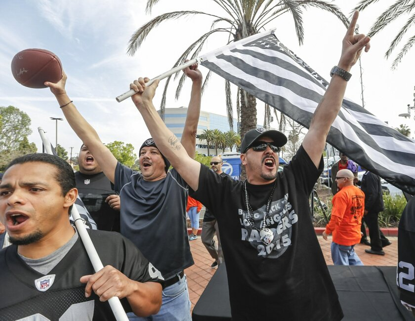 These fans, here celebrating a proposed stadium for the San Diego Chargers and Oakland Raiders, during a news conference in Carson on Feb. 20, are not who really matters when considering an NFL team in Los Angeles. (AP Photo/Damian Dovarganes)